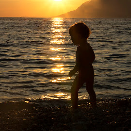 alone at the beach by Maša Pešut Kukina - Babies & Children Toddlers ( swimm, sunset, play, summer, beach, toddler, alone, boy, kid )