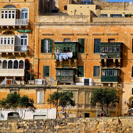 Laundry day in Malta. by Walter Carlson - Buildings & Architecture Architectural Detail ( vacation, travel, high quality, stone wall, building details, in focus, laundry, cruise )