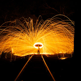 rails and fire by Chris Taylor - Abstract Fire & Fireworks ( abstract, leading lines, railroad tracks, night photography, spinning fire, long exposure, fire )