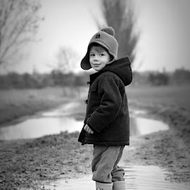I can jump puddles by Melanie Pista - Babies & Children Children Candids ( water, winter, black and white, puddle, boy, hat )