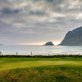 Cloudy sunset by Benny Høynes - Landscapes Prairies, Meadows & Fields ( clouds, fence, sunset, beach, lofoten, colours, fields )