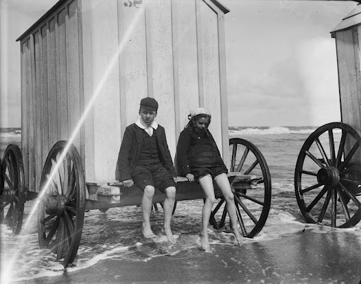 Two young people sitting on a bathing machine