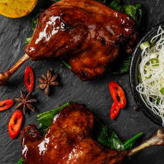 Roast Duck Leg With A Tamarind And Honey Glaze, Rice Noodles And Cucumber Ribbons