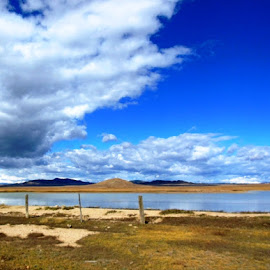 Wind Clouds by Marijo Phelps - Landscapes Cloud Formations ( incredible blue skies, colorado skies, rugged frontier, lake beauty, windy day )