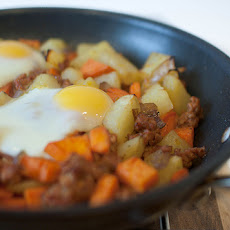 Smoky Sweet Potato Hash With Baked Eggs and Manchego