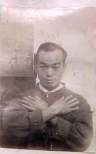 This  1888 photograph of Ah Yot (prisoner number 21726) shows him with his  hands folded across his chest and a board bearing his name. Sometimes prisoners were photographed with their arms crossed on their chest and their hands and fingers clearly displayed. This was to help in the identification process. A prisoner could have a tattoo, a scar, a missing finger, a wart, or some other distinguishing mark on their hands.