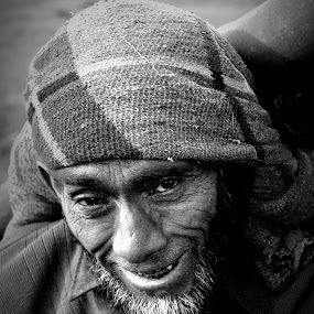 there is a pain behind this smile by Parvesh Rana - Black & White Street & Candid