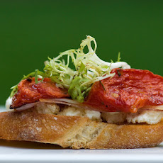 Bruschetta with Rosemary, Roasted Tomato, Ricotta and Proscuitto