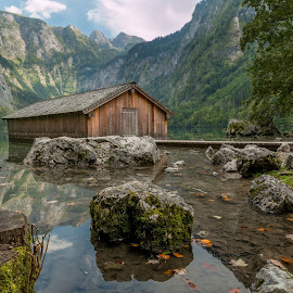 Boathouse at the lake Obersee by Nedzad Jusic - Landscapes Prairies, Meadows & Fields ( water, mountains, boathouse, trees, rocks )