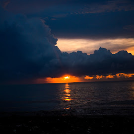 by Ricky Andesta - Landscapes Sunsets & Sunrises ( clouds, indonesia, sunset, beach, sunlight, landscape )