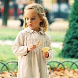 Girl in Place des Vosges by Timothy Carney - Babies & Children Children Candids ( paris, girl, french girl, place des vosges, flower )