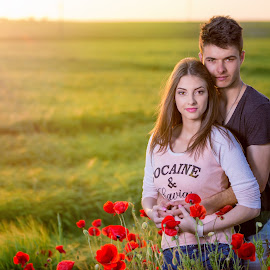 girl 1 by Hermeneanu Valter - People Couples ( wheat field, red flower, sunset )