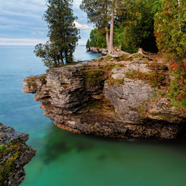 Rocky Cliffs at Cave Point by Kenneth Keifer - Landscapes Travel ( limestone, stone, rock, remote, sky, nature, boulders, lagoon, midwest, cliff, horizon, teal, forest, door peninsula, turquoise, trees, aqua, cave point, early, peninsula, shore, wisconsin, erosion, colorful, rocky, door county, landscape, coastline, coast, jagged, pool, shoreline, transparent, lonely, rugged, luminous, water, clouds, green, eroded, beautiful, stoney, sea, scenic, great lakes, seascape, morning, woods, lake michigan, color, blue, craggy )