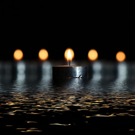 by Dipali S - Artistic Objects Other Objects ( water, abstract, lights, reflection, candles )