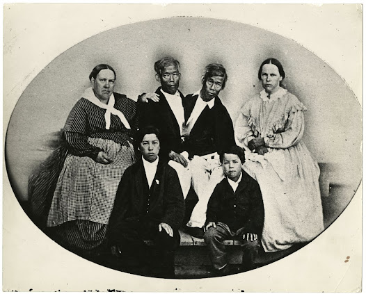 Sarah and Adelaide Yates, husbands Chang and Eng Bunker, and their sons, ca. 1865