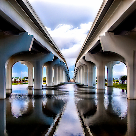 Under The Bridge ll  by Terri Anderson - Buildings & Architecture Bridges & Suspended Structures ( water, blue sky, old town, travel, bridge, vertical lines, pwc,  )