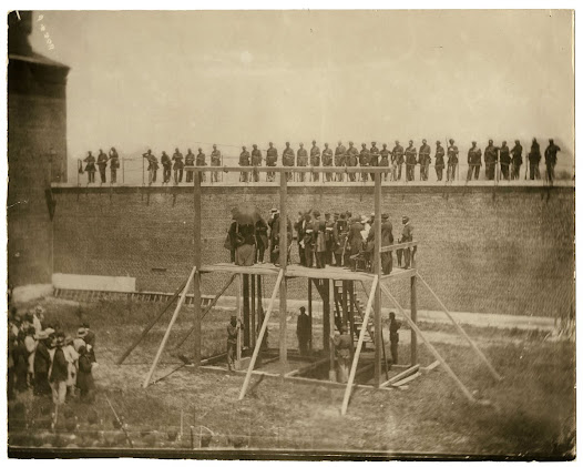 Booth Conspirators hear their sentence on the gallows, July 7, 1865