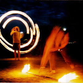Fire dancing at music festival by Hrodulf Steinkampf - People Musicians & Entertainers ( poi, flames, fire stick, music festival, fire dancing, fire )