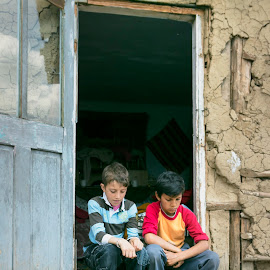 Two boys sitting on the doorstep by Carla Coanda - Babies & Children Children Candids ( countryside, frame, colorful, poverty, colors, framed, boys, door, candid, treshold, doorstep, country, , Travel, People, Lifestyle, Culture )