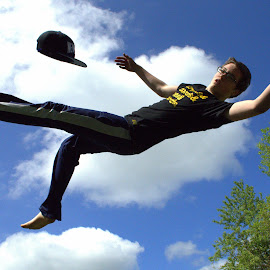 Trampoline? by Ben VanOuse - Sports & Fitness Fitness ( stop action, colorful, teenager, trampoline, falling )