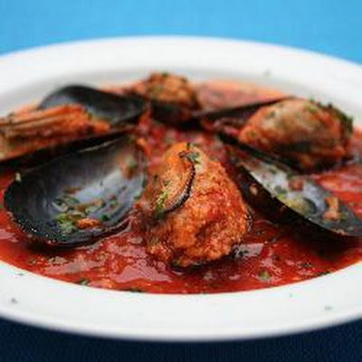 Tuscan Stuffed Mussels In Spicy Tomato Sauce