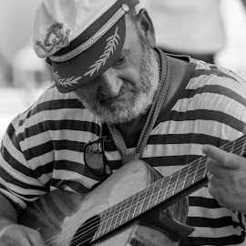 Man and guitar by Monika Tržić - People Portraits of Men ( playing, black and white, guitarist, white, summer, guitar, man, black, entertainment, entertainer, hat,  )