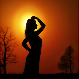 silhouette by Andrius Mačiūnas - People Portraits of Women ( water, red, sunset, silhouette, trees )