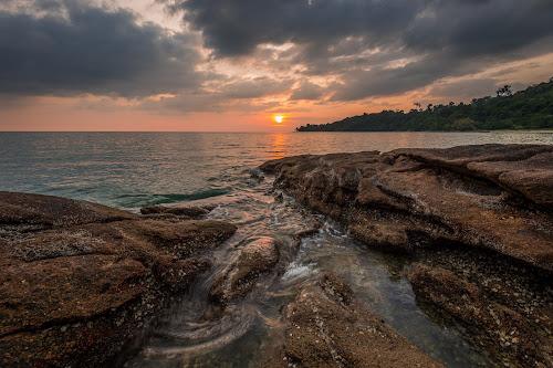 Tides by Mahdi Hussainmiya - Landscapes Sunsets & Sunrises ( tides, clouds, rock formations, flowing, sunset, sea, horizons, dusk )