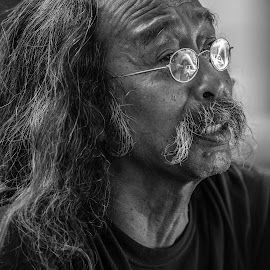 Portrait of an Asian  man with long hair mustache and glasses  by Tony Filson - People Portraits of Men ( glasses, black and white, long hair, mustache, chinese, portrait, man, asian,  )