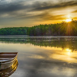 A wolverine sunrise by Calvin Morgan - Landscapes Sunsets & Sunrises ( serene, lake, sunrise, landscape, boat )