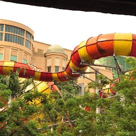 Snake ride by Yasser Abusen - City,  Street & Park  Amusement Parks ( water, orange, snake, amusement park, amusement, waterfall, play, yellow, kids )