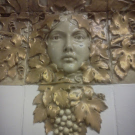 A classical face by Wesley Swank - Artistic Objects Furniture ( sculpture, face, classical, grapes, gold, alabaster )