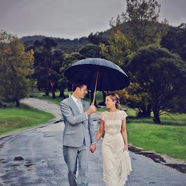 Walking in the Rain by Alan Evans - Wedding Bride & Groom ( wedding photography, rainy day, wedding, wedding day, umbrella, aj photography, wedding dress, bride and groom, bride, groom, rain,  )
