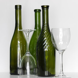 Wine bottles and glasses  by Vita Pundure - Artistic Objects Glass ( wine, glasses, still life, green, beverages, white, restaurant, solid, clean, alcohol, drink, background, glass, composition, bottles, transparent, curved, shiny,  )