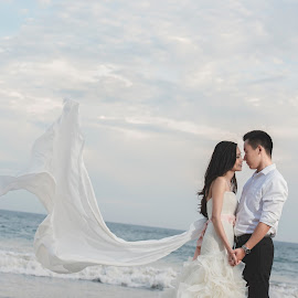 To the world you are one person But to me, you are the world. by Yansen Setiawan - Wedding Bride & Groom ( love, wedding day, weddings, wedding, bride and groom, beach, lover, trash the dress )