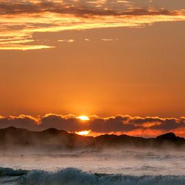Subzero Sunrise by Josh Blash - Landscapes Sunsets & Sunrises ( clouds, water, orange, waves, ocean, beach, sun, dawn, winter, sky, fog, sunrise, steam )