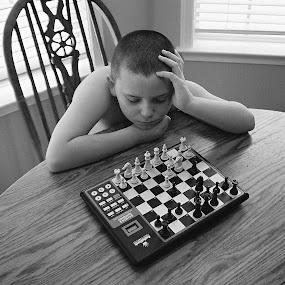 It's White's Move by Paul Hopkins - Babies & Children Children Candids (  )