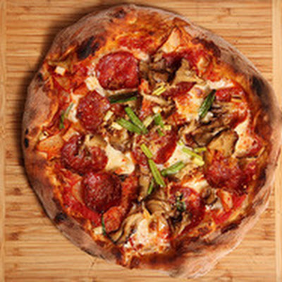 New York Style Pizza with Kimchi, Soppressata, and Maitake Mushrooms