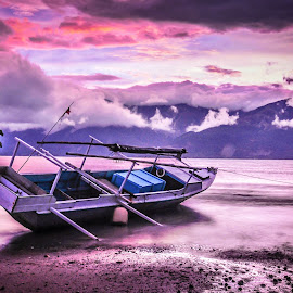 a fishing boat resting on the  mamboro beach by Dedik Dwi Nugroho - Transportation Boats