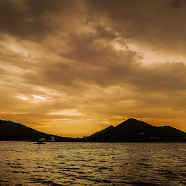 Fiery Sunset  by Havneet Singh - Landscapes Sunsets & Sunrises ( clouds, mountains, waterscape, udaipur, sunset, fatehsagar lake )