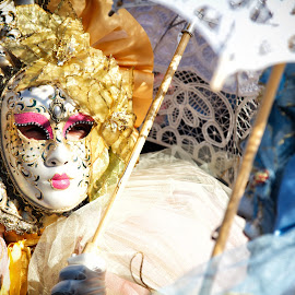 Venice carnival mask by G B - News & Events Entertainment ( person, italian, arts, pull, makeup, masquerade, masks, mask, party, feather, fest, city, venetian, hide, event, cheerful, custom, farce, colors, mysterious, fun, shows, holiday, dress, venice, quality, column, culture, face, ornate, decorative, colorful, joy, tradition, festival, couple, baby, italy, purple, decoration, carnival, elegance, play, venezia, two, red, color, hidden, costume, square )
