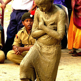 Living Statue by Saikat Kundu - People Body Art/Tattoos ( up close, statue, mud, football, body art, still, candid, saikat kundu, natural, close up, boy )