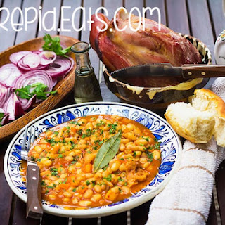 Romanian baked beans with smoked pork knuckle. Traditional baked beans with smoked meat.