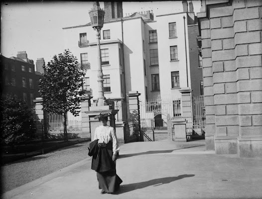Woman carrying book on her way into the National Library