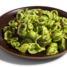 Pasta with Arugula Pesto, Sun-Dried Tomatoes, and Pine Nuts Recipe