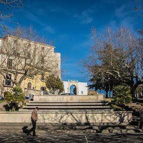 Old Man Walking by Sabrina Campagna - City,  Street & Park  Street Scenes ( old, walking, montemiletto, borgo medioevale, borgo, street, street photography, campania, blue sky, piazza, square, italy, man )
