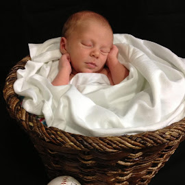 Sleeping baby by Jessica Williams Bender - Babies & Children Babies ( newborn photography, baseball, newborn in a basket, bat, baby,  )