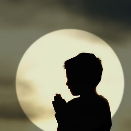 A child's prayer by Jessica Williams Bender - Landscapes Sunsets & Sunrises ( contre-jour, child praying, silhouette, against the light., silhouette of child praying,  )