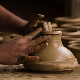 Potter by Kashf Gee - Artistic Objects Antiques ( clay, sand, potter, pot )
