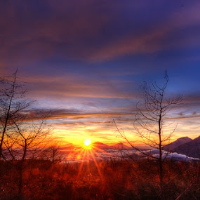 It's not the mountain we conquer, but ourselves. by Kresnata Adijaya - Landscapes Sunsets & Sunrises ( mountain, sunrise )